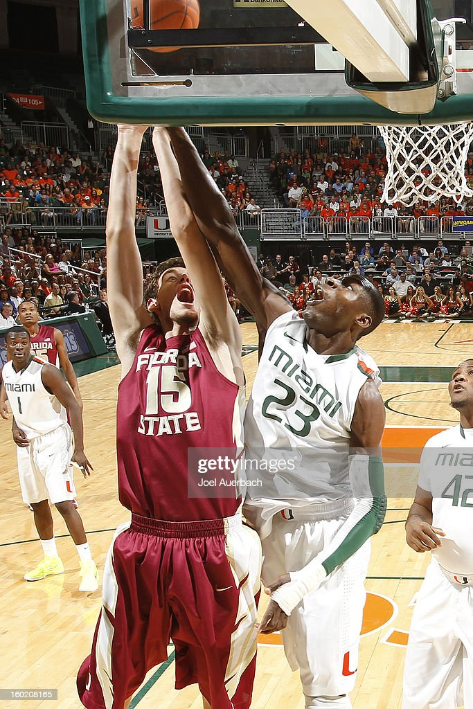 Boris Bojanovsky #15 of the Florida State Seminoles and Tonye Jekiri #23 of the Miami Hurricanes battle for a rebound on January 27, 2013 at the BankUnited Center in Coral Gables, Florida. The Hurricanes defeated the Seminoles 71-47.