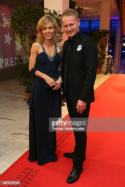 Boris Buechler and Annika Zimmermann arrive the red carpet during the German Media Award 2014 on January 23 2015 in BadenBaden Germany