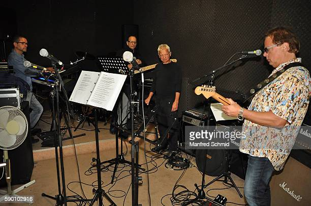 Boris Bukowski and members of Opus perform in a rehearsal room for the upcoming Hafen Open Air Vienna Festival on August 12 2016 in Vienna Austria