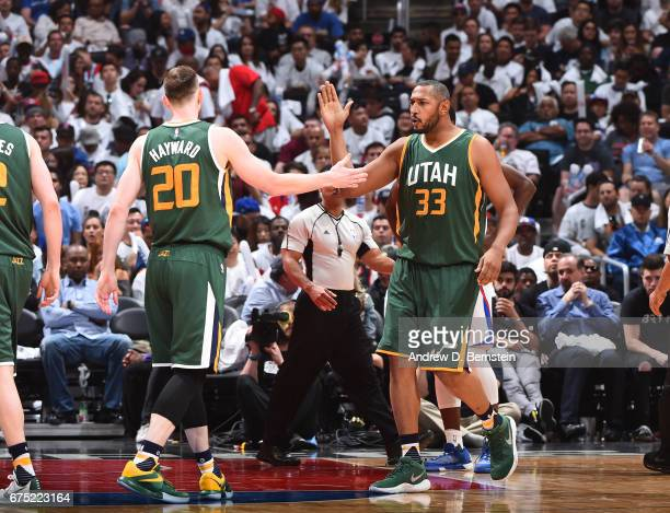 Boris Diaw and Gordon Hayward of the Utah Jazz highfive during Game Seven of the Western Conference Quarterfinals of the 2017 NBA Playoffs on April...