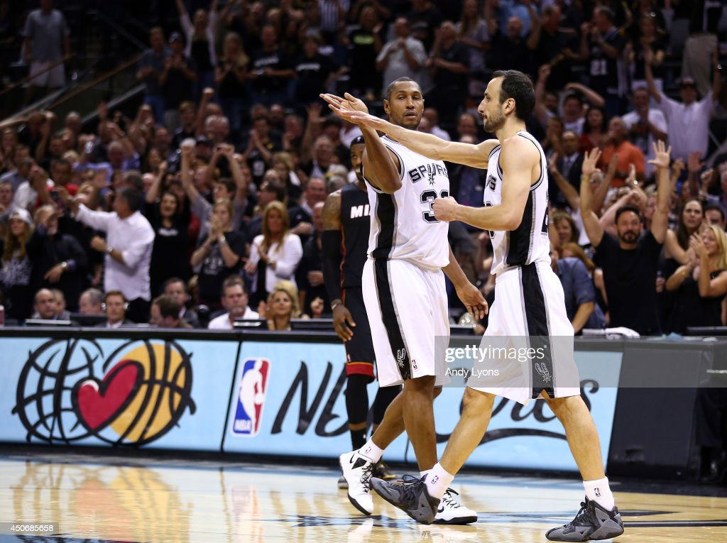 <a gi-track='captionPersonalityLinkClicked' href=/galleries/search?phrase=Boris+Diaw&family=editorial&specificpeople=201505 ng-click='$event.stopPropagation()'>Boris Diaw</a> #33 and Manu Ginobili #20 of the San Antonio Spurs celebrate against the Miami Heat during Game Five of the 2014 NBA Finals at the AT&T Center on June 15, 2014 in San Antonio, Texas.