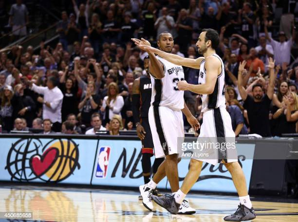 Boris Diaw and Manu Ginobili of the San Antonio Spurs celebrate against the Miami Heat during Game Five of the 2014 NBA Finals at the ATT Center on...