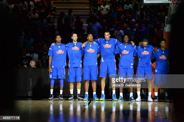 Boris Diaw and Rudy Gobert of the France National Team stands for the National Anthem against the Lithuania National Team at Palacio de Deportes on...