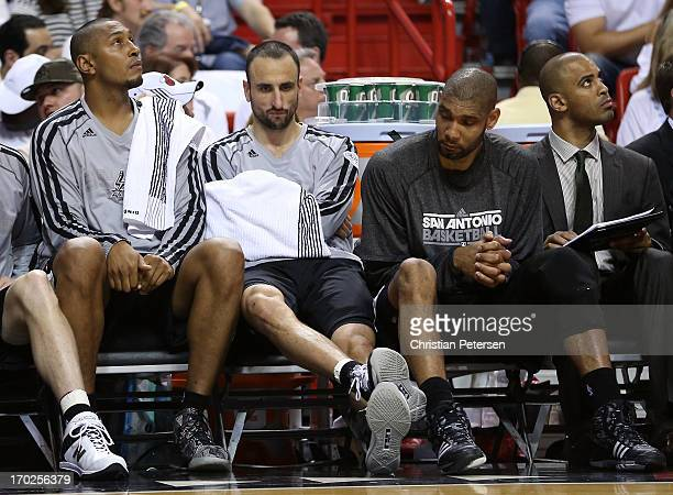 Boris Diaw Manu Ginobili and Tim Duncan of the San Antonio Spurs sit on the bench in the fourth quarter while taking on the Miami Heat during Game...