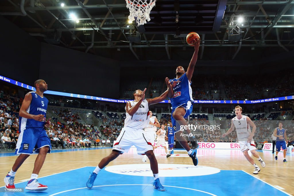 <a gi-track='captionPersonalityLinkClicked' href=/galleries/search?phrase=Boris+Diaw&family=editorial&specificpeople=201505 ng-click='$event.stopPropagation()'>Boris Diaw</a> of France is challenged by <a gi-track='captionPersonalityLinkClicked' href=/galleries/search?phrase=Alex+King+-+Basketball+Player&family=editorial&specificpeople=15221455 ng-click='$event.stopPropagation()'>Alex King</a> of Germany during the international friendly match between Germany and France at SAP Arena on August 6, 2013 in Mannheim, Germany.