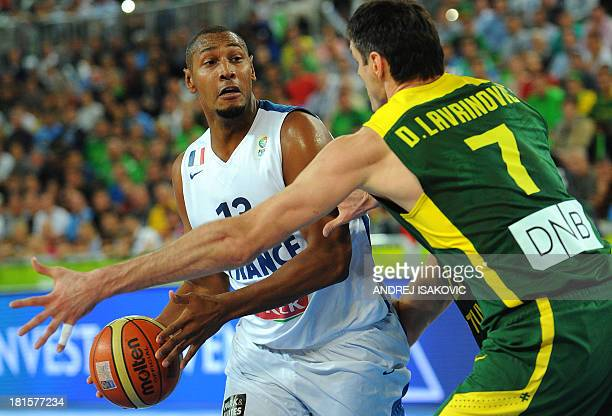Boris Diaw of France vies with Darjus Lavrinovic of Lithuania during the EuroBasket championships basketball final match between France and Lithuania...