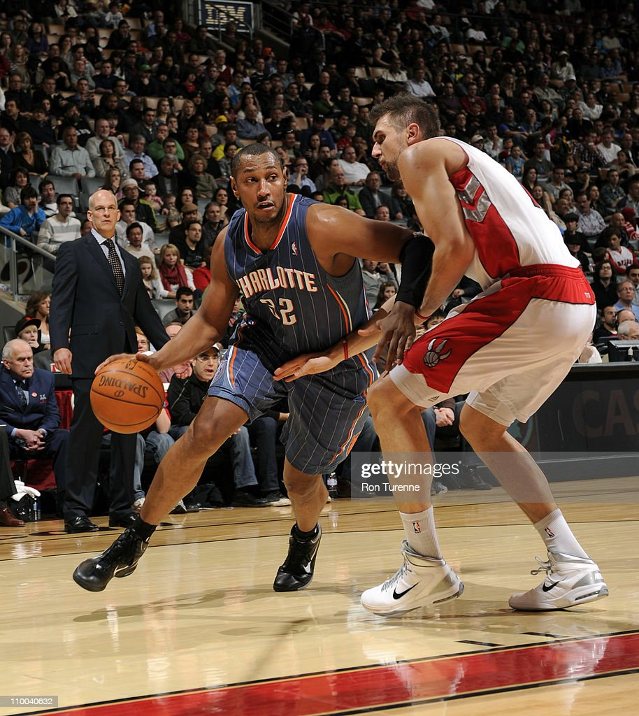<a gi-track='captionPersonalityLinkClicked' href=/galleries/search?phrase=Boris+Diaw&family=editorial&specificpeople=201505 ng-click='$event.stopPropagation()'>Boris Diaw</a> #32 of the Charlotte Bobcats drives to the basket against <a gi-track='captionPersonalityLinkClicked' href=/galleries/search?phrase=Andrea+Bargnani&family=editorial&specificpeople=533014 ng-click='$event.stopPropagation()'>Andrea Bargnani</a> #7 of the Toronto Raptors during the game on March 13, 2011 at the Air Canada Centre in Toronto, Ontario, Canada.