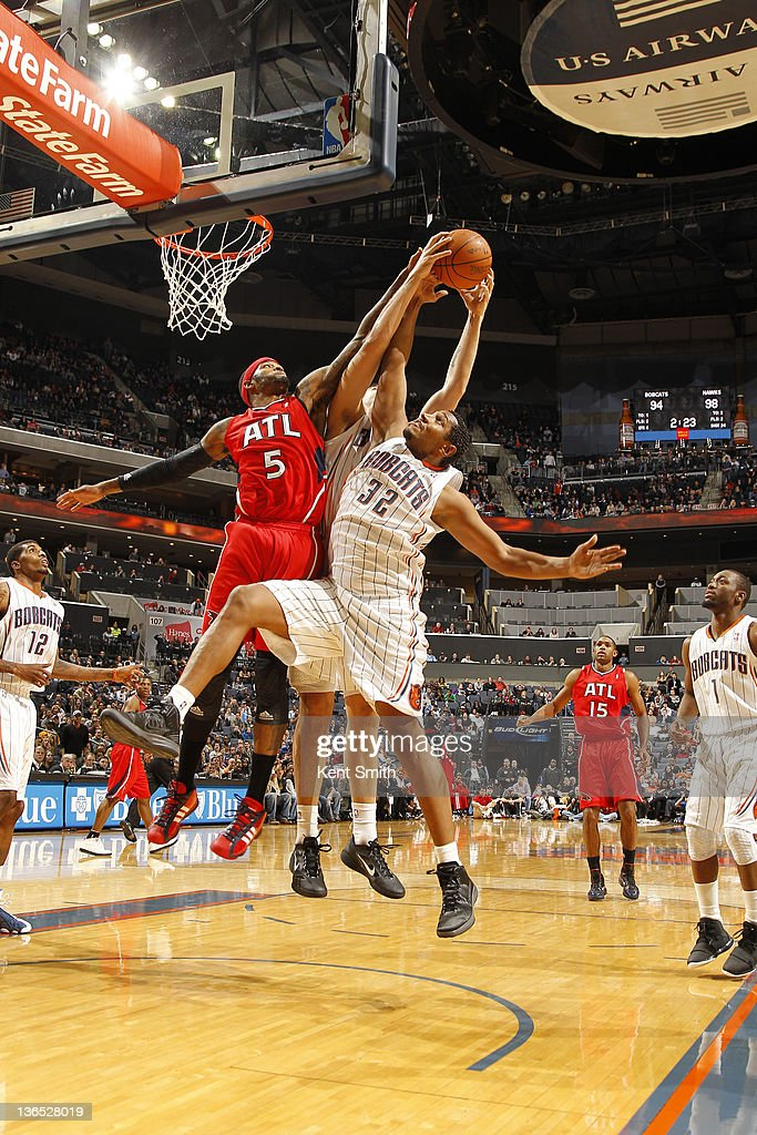 Boris Diaw #32 of the Charlotte Bobcats fights for the ball against Josh Smith #5 of the Atlanta Hawks during the game at the Time Warner Cable Arena on January 6, 2012 in Charlotte, North Carolina.