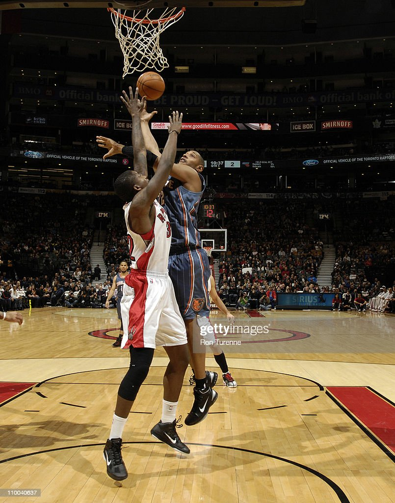 <a gi-track='captionPersonalityLinkClicked' href=/galleries/search?phrase=Boris+Diaw&family=editorial&specificpeople=201505 ng-click='$event.stopPropagation()'>Boris Diaw</a> #32 of the Charlotte Bobcats shoots against Ed Davis #32 of the Toronto Raptors during the game on March 13, 2011 at the Air Canada Centre in Toronto, Ontario, Canada.