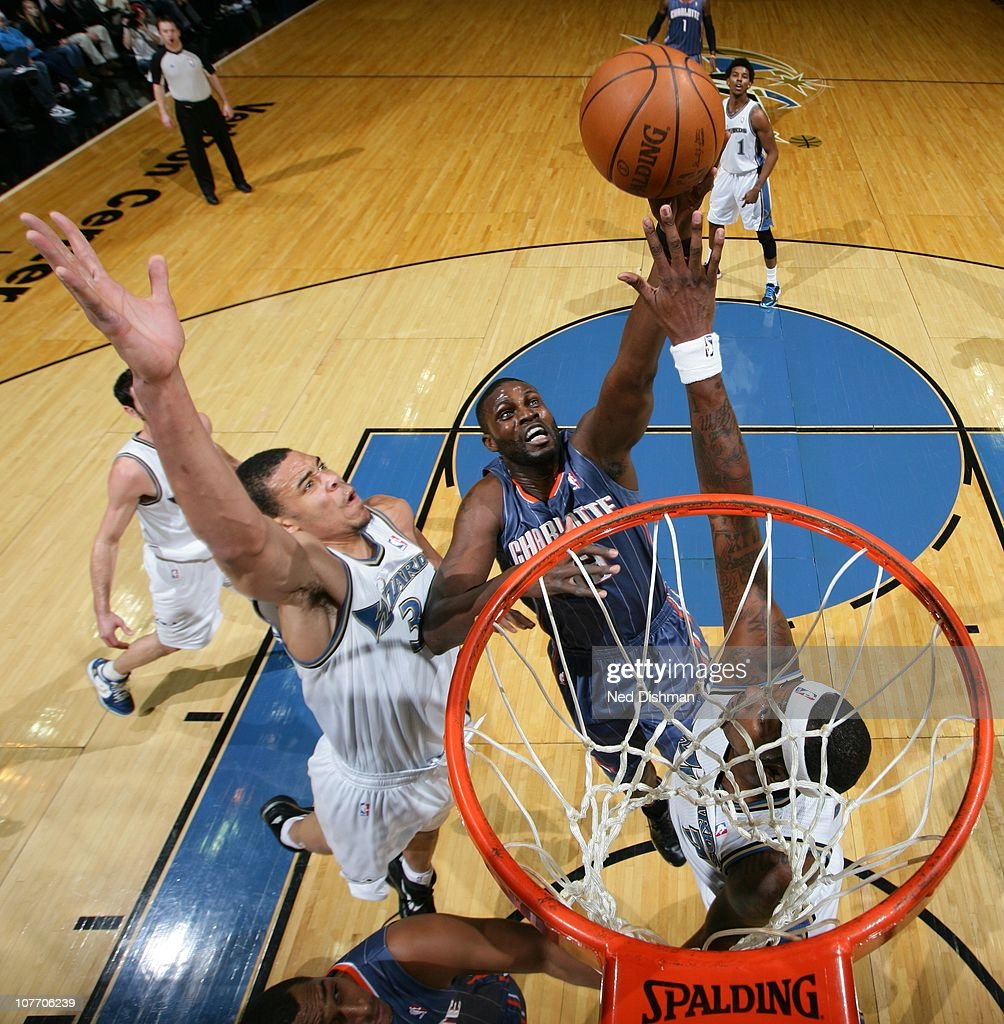 Boris Diaw of the Charlotte Bobcats shoots against JaVale McGee of the Washington Wizards at the Verizon Center on December 20 2010 in Washington DC...