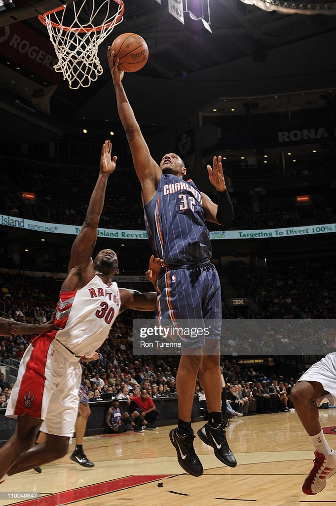 <a gi-track='captionPersonalityLinkClicked' href=/galleries/search?phrase=Boris+Diaw&family=editorial&specificpeople=201505 ng-click='$event.stopPropagation()'>Boris Diaw</a> #32 of the Charlotte Bobcats shoots against <a gi-track='captionPersonalityLinkClicked' href=/galleries/search?phrase=Reggie+Evans&family=editorial&specificpeople=202254 ng-click='$event.stopPropagation()'>Reggie Evans</a> #30 of the Toronto Raptors during the game on March 13, 2011 at the Air Canada Centre in Toronto, Ontario, Canada.