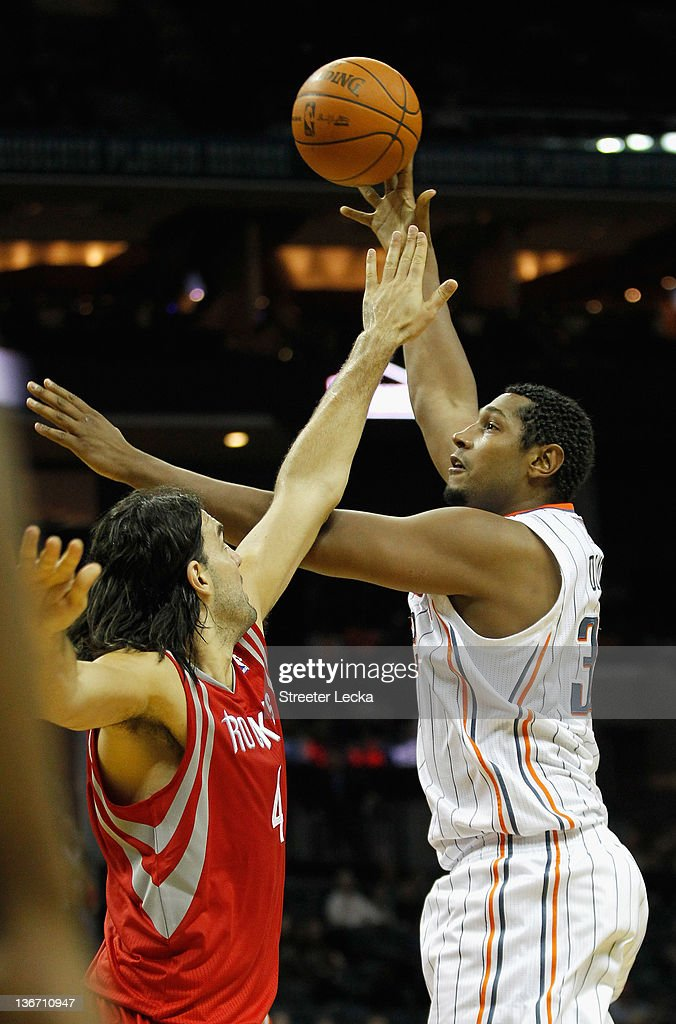 Boris Diaw #32 of the Charlotte Bobcats shoots the ball over Luis Scola #4 of the Houston Rockets during their game at Time Warner Cable Arena on January 10, 2012 in Charlotte, North Carolina.