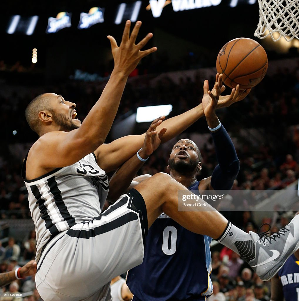 Boris Diaw of the San Antonio Spurs battles JaMychal Green of the Memphis Grizzlies for a rebound in Game One of the Western Conference Quarterfinals...