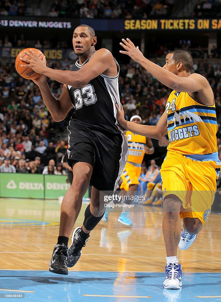 <a gi-track='captionPersonalityLinkClicked' href=/galleries/search?phrase=Boris+Diaw&family=editorial&specificpeople=201505 ng-click='$event.stopPropagation()'>Boris Diaw</a> #33 of the San Antonio Spurs controls the ball against <a gi-track='captionPersonalityLinkClicked' href=/galleries/search?phrase=Andre+Miller&family=editorial&specificpeople=201678 ng-click='$event.stopPropagation()'>Andre Miller</a> #24 of the Denver Nuggets at the Pepsi Center on December 18, 2012 in Denver, Colorado. The Nuggets defeated the Spurs 112-106.