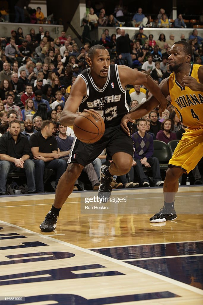 <a gi-track='captionPersonalityLinkClicked' href=/galleries/search?phrase=Boris+Diaw&family=editorial&specificpeople=201505 ng-click='$event.stopPropagation()'>Boris Diaw</a> #33 of the San Antonio Spurs drives baseline vs the Indiana Pacers on November 23, 2012 at Bankers Life Fieldhouse in Indianapolis, Indiana.