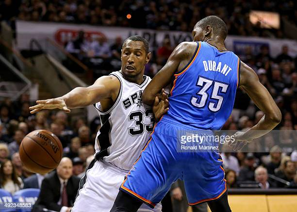 Boris Diaw of the San Antonio Spurs drives on Kevin Durant of the Oklahoma City Thunder in the first quarter in Game One of the Western Conference...
