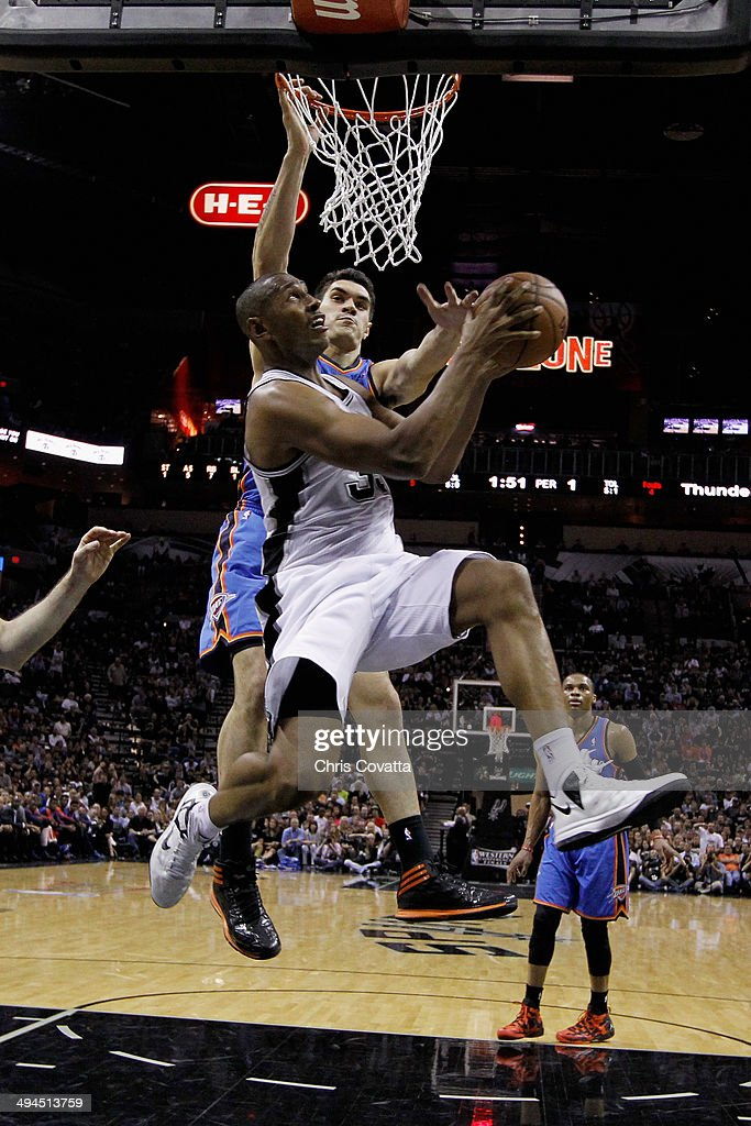 Boris Diaw #33 of the San Antonio Spurs drives to the basket against Steven Adams #12 of the Oklahoma City Thunder in the second quarter during Game Five of the Western Conference Finals of the 2014 NBA Playoffs at AT&T Center on May 29, 2014 in San Antonio, Texas.