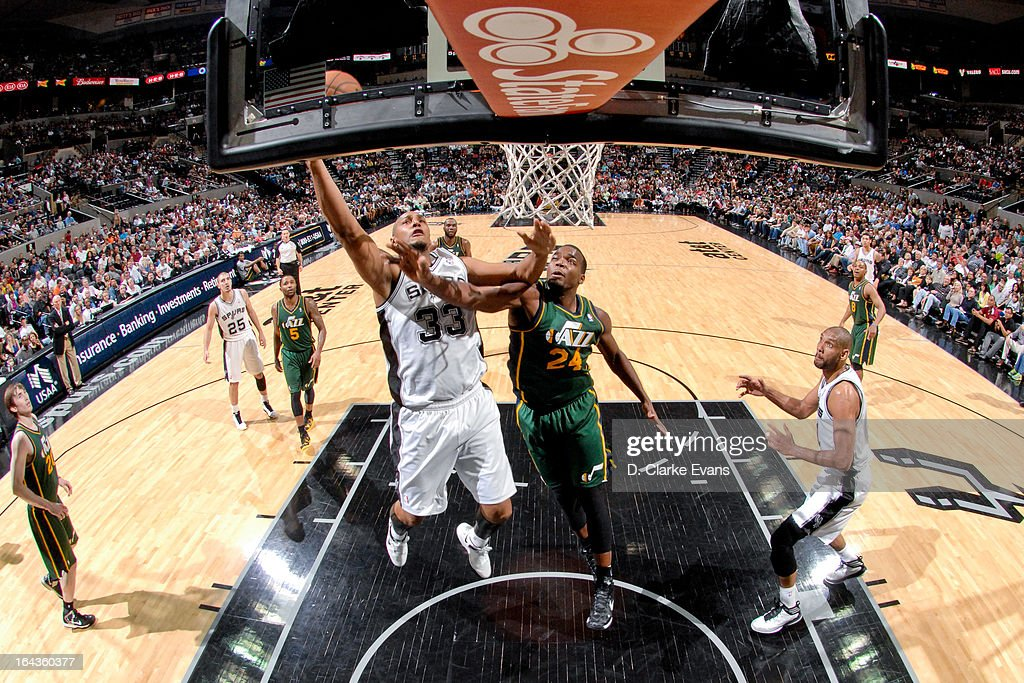 Boris Diaw #33 of the San Antonio Spurs drives to the basket against Paul Millsap #24 of the Utah Jazz on March 22, 2013 at the AT&T Center in San Antonio, Texas.