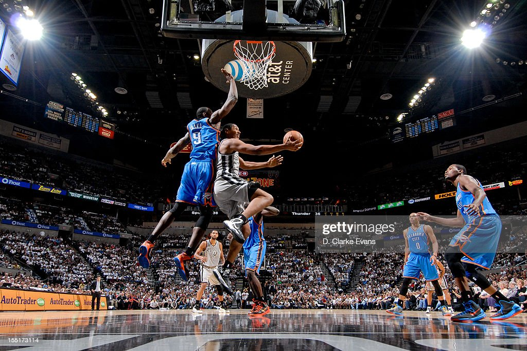 <a gi-track='captionPersonalityLinkClicked' href=/galleries/search?phrase=Boris+Diaw&family=editorial&specificpeople=201505 ng-click='$event.stopPropagation()'>Boris Diaw</a> #33 of the San Antonio Spurs goes for a reverse layup against <a gi-track='captionPersonalityLinkClicked' href=/galleries/search?phrase=Serge+Ibaka&family=editorial&specificpeople=5133378 ng-click='$event.stopPropagation()'>Serge Ibaka</a> #9 of the Oklahoma City Thunder on November 1, 2012 at the AT&T Center in San Antonio, Texas.