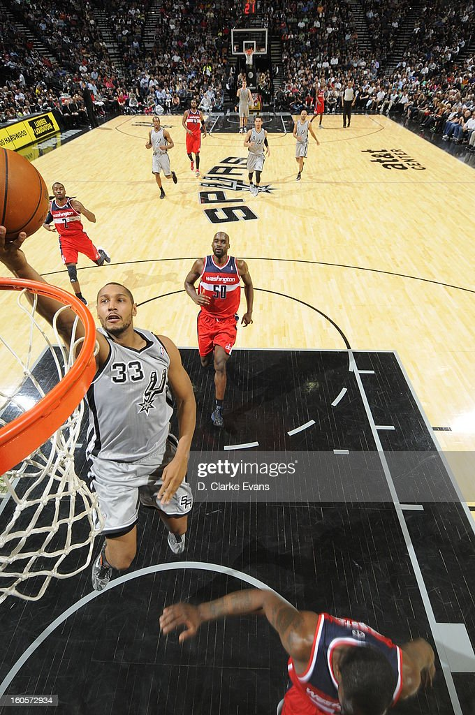 <a gi-track='captionPersonalityLinkClicked' href=/galleries/search?phrase=Boris+Diaw&family=editorial&specificpeople=201505 ng-click='$event.stopPropagation()'>Boris Diaw</a> #33 of the San Antonio Spurs goes to the basket during the game between the Washington Wizards and the San Antonio Spurs on February 2, 2013 at the AT&T Center in San Antonio, Texas.