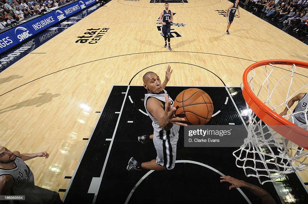 Boris Diaw #33 of the San Antonio Spurs grabs a rebound against the Memphis Grizzlies at the AT&T Center on October 30, 2013 in San Antonio, Texas.