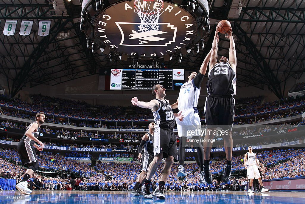Boris Diaw #33 of the San Antonio Spurs grabs a rebound against the Dallas Mavericks in Game Four of the Western Conference Quarterfinals during the 2014 NBA Playoffs on April 28, 2014 at the American Airlines Center in Dallas, Texas.
