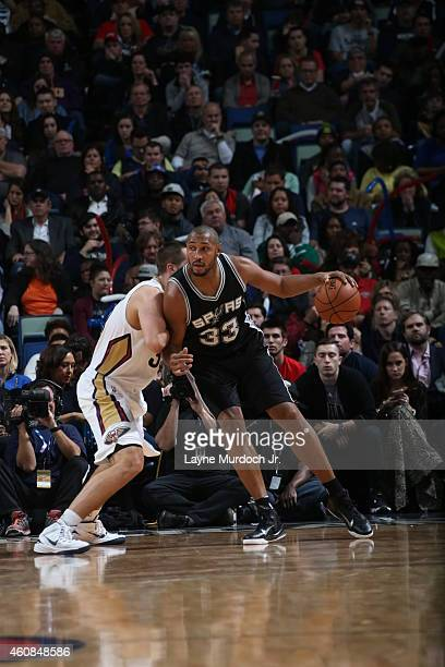Boris Diaw of the San Antonio Spurs handles the ball against the New Orleans Pelicans on December 26 2014 at Smoothie King Center in New Orleans...