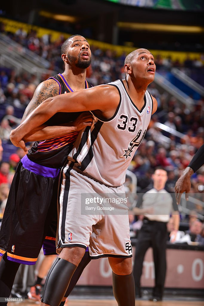<a gi-track='captionPersonalityLinkClicked' href=/galleries/search?phrase=Boris+Diaw&family=editorial&specificpeople=201505 ng-click='$event.stopPropagation()'>Boris Diaw</a> #33 of the San Antonio Spurs holds position against Marcus Morris #15 of the Phoenix Suns on February 24, 2013 at U.S. Airways Center in Phoenix, Arizona.
