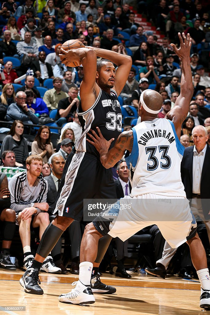 Boris Diaw #33 of the San Antonio Spurs looks to pass the ball against Dante Cunningham #33 of the Minnesota Timberwolves on February 6, 2013 at Target Center in Minneapolis, Minnesota.