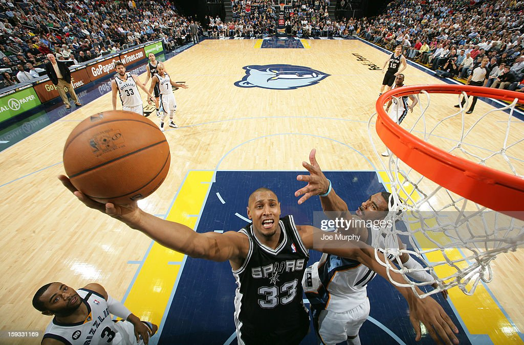 <a gi-track='captionPersonalityLinkClicked' href=/galleries/search?phrase=Boris+Diaw&family=editorial&specificpeople=201505 ng-click='$event.stopPropagation()'>Boris Diaw</a> #33 of the San Antonio Spurs shoots a layup against Mike Conley #11 of the Memphis Grizzlies on January 11, 2013 at FedExForum in Memphis, Tennessee.