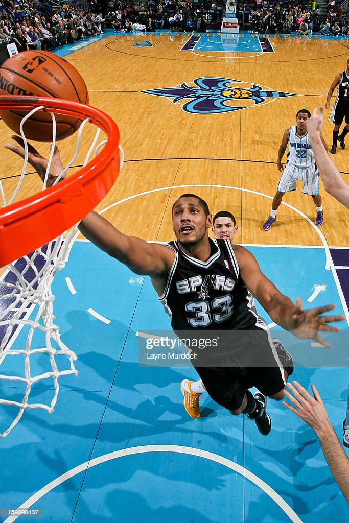 Boris Diaw #33 of the San Antonio Spurs shoots a layup against the New Orleans Hornets on January 7, 2013 at the New Orleans Arena in New Orleans, Louisiana.
