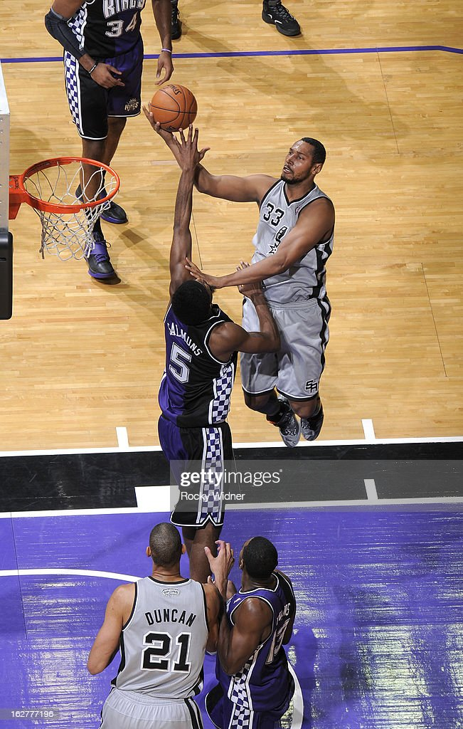 Boris Diaw #33 of the San Antonio Spurs shoots against John Salmons #5 of the Sacramento Kings on February 19, 2013 at Sleep Train Arena in Sacramento, California.