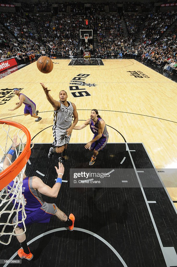 Boris Diaw #33 of the San Antonio Spurs shoots against the Phoenix Suns on January 26, 2013 at the AT&T Center in San Antonio, Texas.
