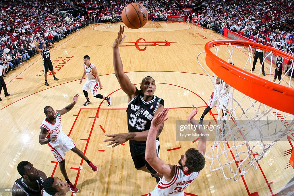 <a gi-track='captionPersonalityLinkClicked' href=/galleries/search?phrase=Boris+Diaw&family=editorial&specificpeople=201505 ng-click='$event.stopPropagation()'>Boris Diaw</a> #33 of the San Antonio Spurs shoots in the lane against <a gi-track='captionPersonalityLinkClicked' href=/galleries/search?phrase=Chandler+Parsons&family=editorial&specificpeople=4249869 ng-click='$event.stopPropagation()'>Chandler Parsons</a> #25 of the Houston Rockets on December 10, 2012 at the Toyota Center in Houston, Texas.