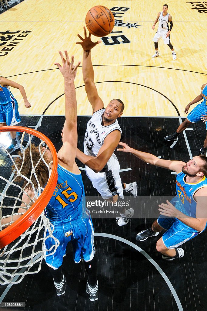 <a gi-track='captionPersonalityLinkClicked' href=/galleries/search?phrase=Boris+Diaw&family=editorial&specificpeople=201505 ng-click='$event.stopPropagation()'>Boris Diaw</a> #33 of the San Antonio Spurs shoots in the lane against <a gi-track='captionPersonalityLinkClicked' href=/galleries/search?phrase=Robin+Lopez&family=editorial&specificpeople=2351509 ng-click='$event.stopPropagation()'>Robin Lopez</a> #15 of the New Orleans Hornets on December 21, 2012 at the AT&T Center in San Antonio, Texas.