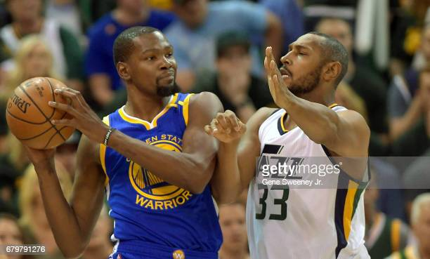 Boris Diaw of the Utah Jazz defends against Kevin Durant of the Golden State Warriors in the first half in Game Three of the Western Conference...