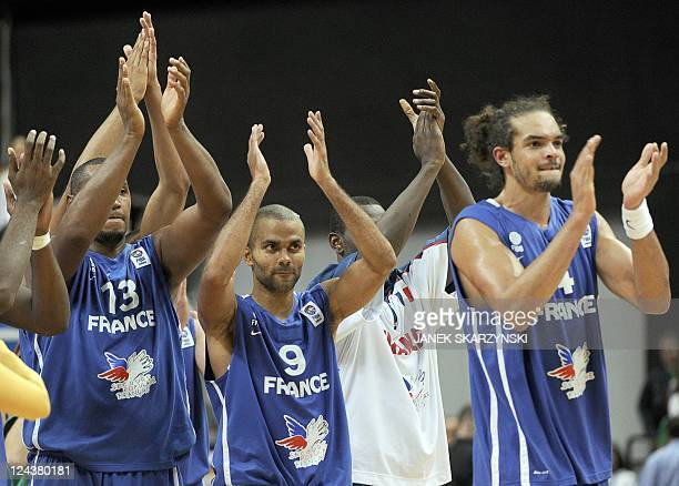 Boris Diaw Tony Parker and Joakim Noah of France thank fans after a game against Lithuania during a EuroBasket 2011 second round group E basketball...