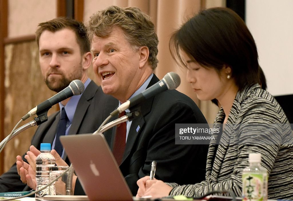 Boris Dittrich (C), Advocacy Derictor of LGBT rights program of the Human Rithts Watch (HRW), makes a speech beside researcher of HRW LGBT rights program Kyle Knight (L) and Dirctor of the HRW Japan Kanae Doi (R) during a press conference in Tokyo on May 6, 2016. Human Rithts Watch reported that Japanese schools are filled with 'hateful' comments directed at gay and transgendered people, including from teachers, which aggravate bullying and drive some students into depression. / AFP / TORU
