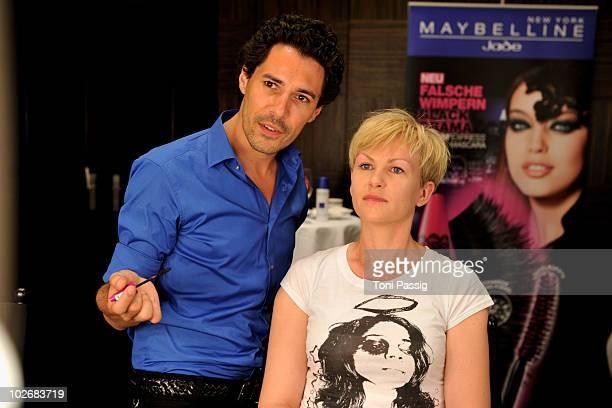 Boris Entrup and Karen Heinrichs seen backstage at the Guido Maria Kretschmer Show during the Mercedes Benz Fashion Week Spring/Summer 2011 at...