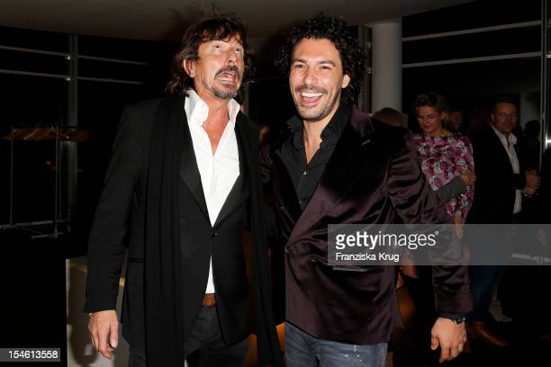 Boris Entrup and Tom Lemke attend the opening night of 'Smoke@thewater' by Tom Lemke at the der Richard Meier Villa on October 23 2012 in Hamburg...