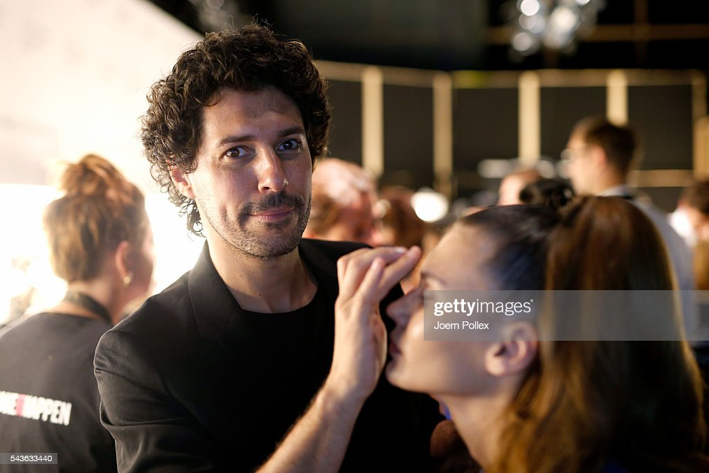 Boris Entrup prepares a model backstage ahead of the Guido Maria Kretschmer show during the Mercedes-Benz Fashion Week Berlin Spring/Summer 2017 at Erika Hess Eisstadion on June 29, 2016 in Berlin, Germany.