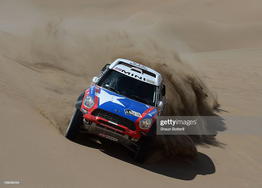 Boris Garafulic and co-driver Gilles Picard of team Mini compete in stage 6 from Arica to Calama during the 2013 Dakar Rally on January 10, 2013 in Arica, Chile.