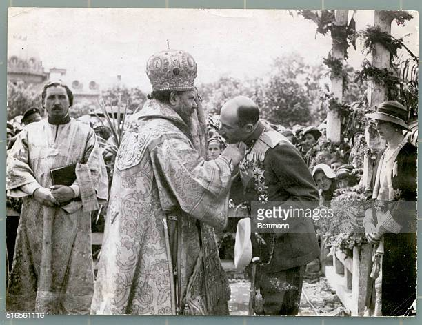 Boris III King of Bulgaria shown kissing the crucifix on Day of Holy St George He is seen with his wife