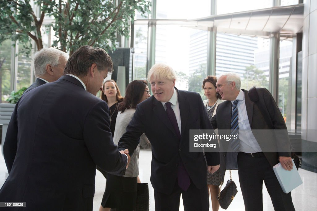 <a gi-track='captionPersonalityLinkClicked' href=/galleries/search?phrase=Boris+Johnson&family=editorial&specificpeople=209016 ng-click='$event.stopPropagation()'>Boris Johnson</a>, mayor of London, center, arrives at Cheung Kong Center in Hong Kong, China, on Friday, Oct. 18, 2013. Johnson is in China as part of a delegation led by Chancellor of the Exchequer George Osborne to boost business links with the worlds second-largest economy. Photographer: Brent Lewin/Bloomberg via Getty Images