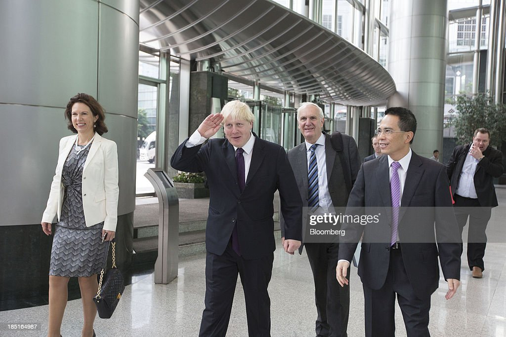 <a gi-track='captionPersonalityLinkClicked' href=/galleries/search?phrase=Boris+Johnson&family=editorial&specificpeople=209016 ng-click='$event.stopPropagation()'>Boris Johnson</a>, mayor of London, gestures as he walks next to Victor Li, deputy chairman of Cheung Kong (Holdings) Ltd., right, in Cheung Kong Center in Hong Kong, China, on Friday, Oct. 18, 2013. Johnson is in China as part of a delegation led by Chancellor of the Exchequer George Osborne to boost business links with the worlds second-largest economy. Photographer: Brent Lewin/Bloomberg via Getty Images