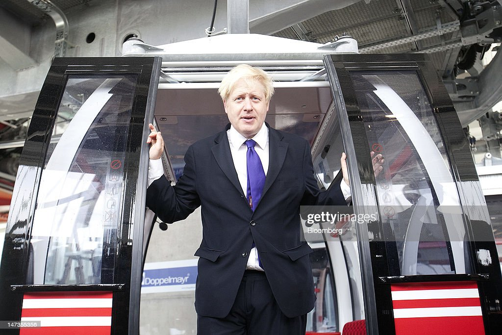 <a gi-track='captionPersonalityLinkClicked' href=/galleries/search?phrase=Boris+Johnson&family=editorial&specificpeople=209016 ng-click='$event.stopPropagation()'>Boris Johnson</a>, mayor of London, poses for a photograph during the opening of the Emirates Air Line, a cable car crossing above the River Thames operated by Emirates, in London, U.K., on Thursday, June 28, 2012. The cable car system will run between Greenwich Peninsula and the Royal Victoria Docks. Photographer: Simon Dawson/Bloomberg via Getty Images