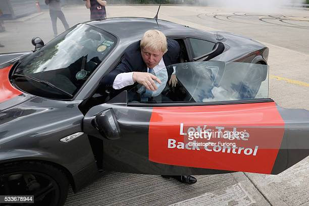 Boris Johnson MP emerges from a sports car after it performed 'donuts' during a visit to Ginetta Sports cars as part of the Brexit Battle Bus tour in...
