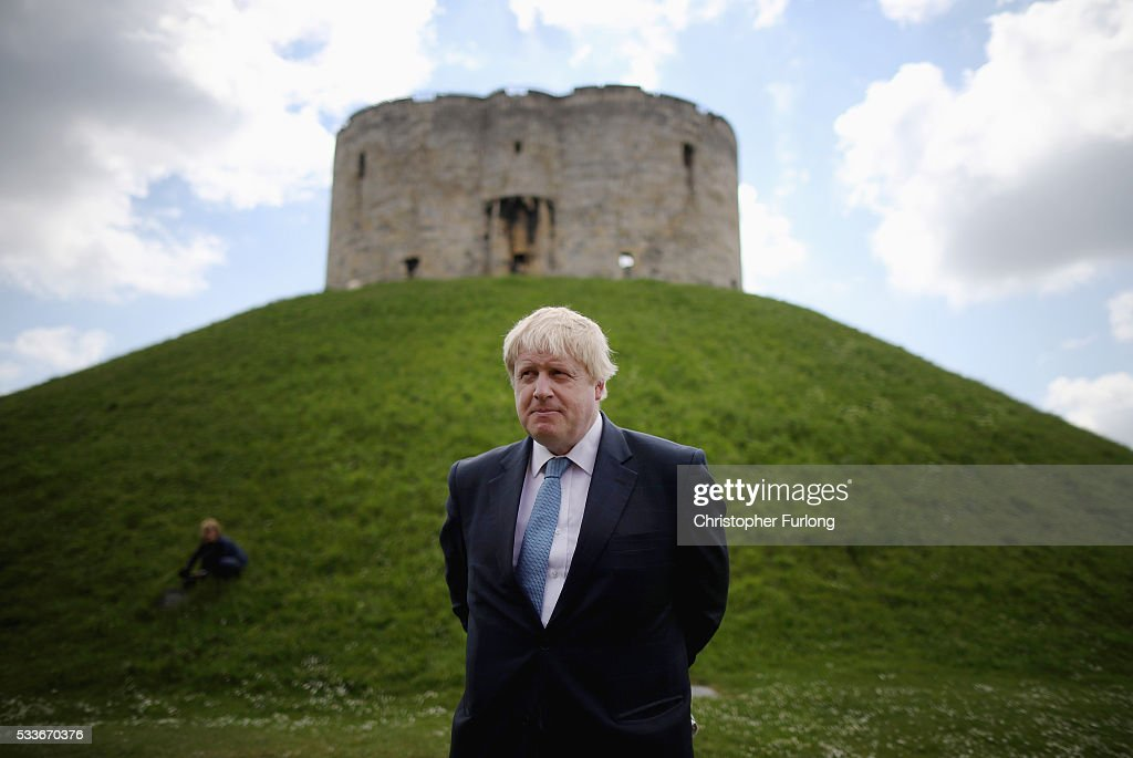 Boris Johnson MP poses for the media next to Clifford's Tower in York during the Brexit Battle Bus tour in Yorkshire on May 23 2016 in York England...