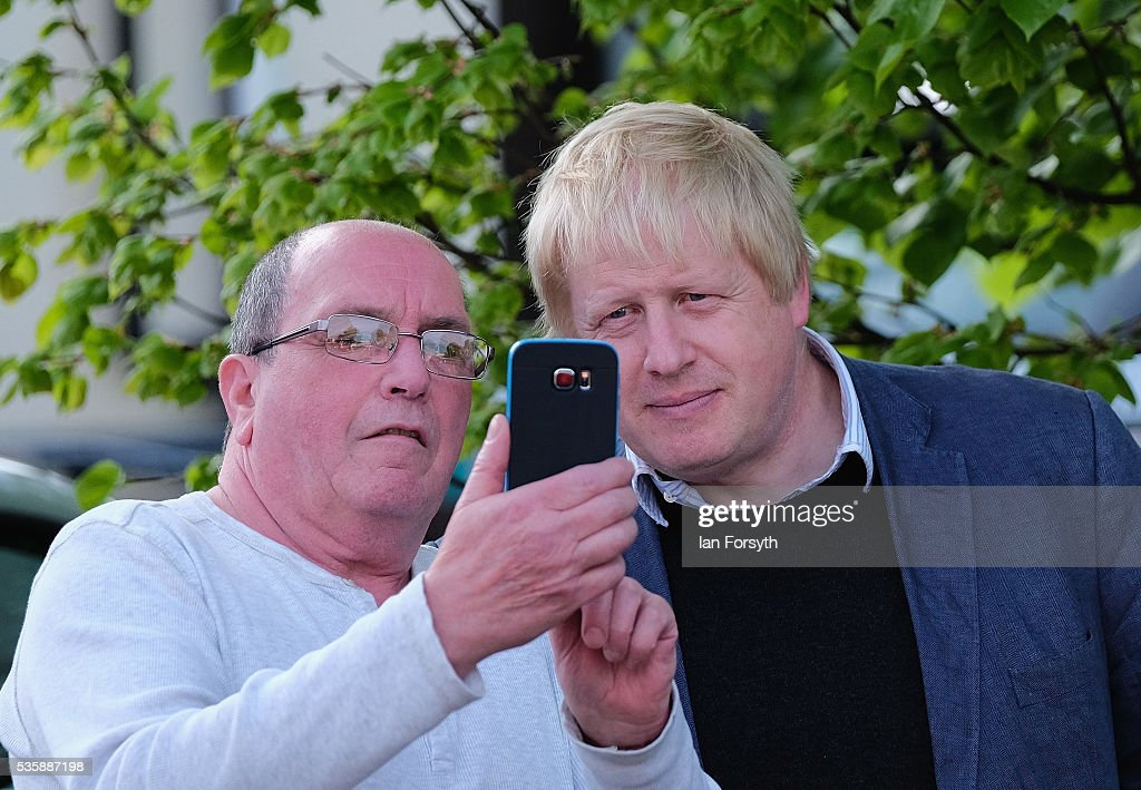 Boris Johnson MP (R) stops for a selfy with a member of the public during a visit Chester-Le-Street Cricket Club as part of the Brexit tour on May 30, 2016 in Chester-Le-Street, England. Boris Johnson and the Vote Leave campaign are touring the UK in their Brexit Battle Bus on a campaign hoping to persuade voters to back leaving the European Union in the June 23rd referendum.