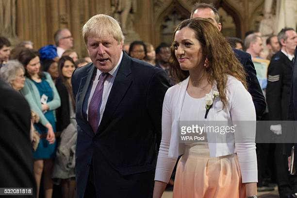 Boris Johnson MP talks to SNP Tasmina AhmedSheikh as they pass through the Central lobby walk of the House of Lords for the State Opening of...